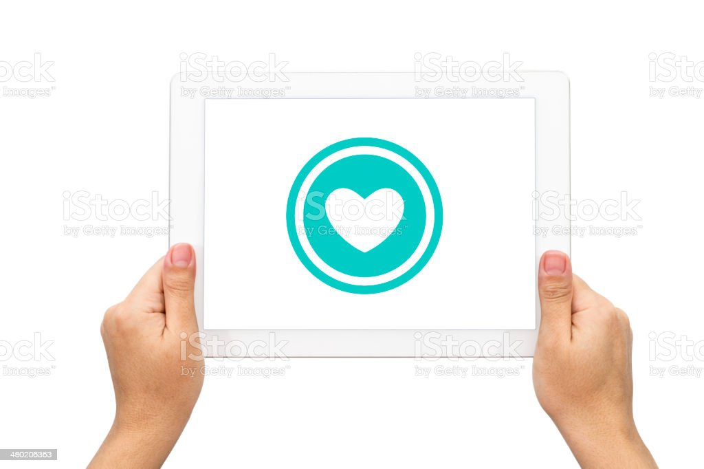 Heart icon, hand with tablet stock photo