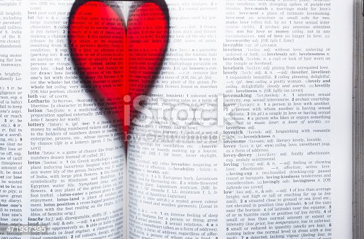 a heart-shaped shadow in a book