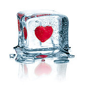 Concept photography of a frozen heart in an ice cube.