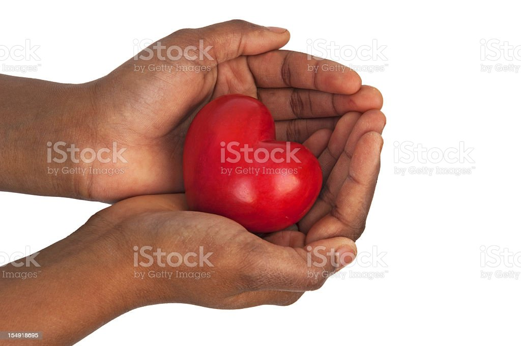 heart in open hands isolated on white stock photo