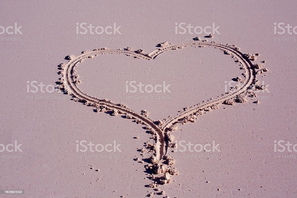 Heart in pink sand stock photo