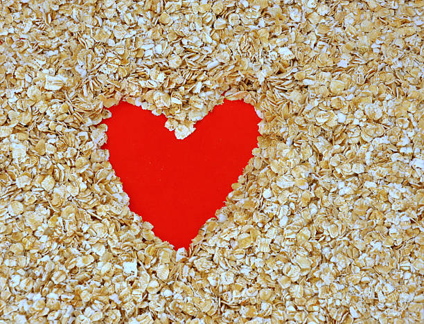 Heart In Rolled Oats stock photo