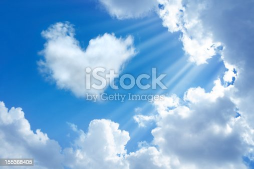 heart shaped cloud in cloudy sky  and sunbeam.
