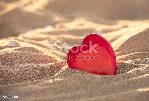 istock Heart in the sand 589111156