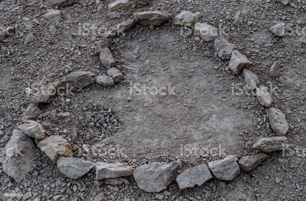 Heart is lined with stone on the ground. royalty-free stock photo