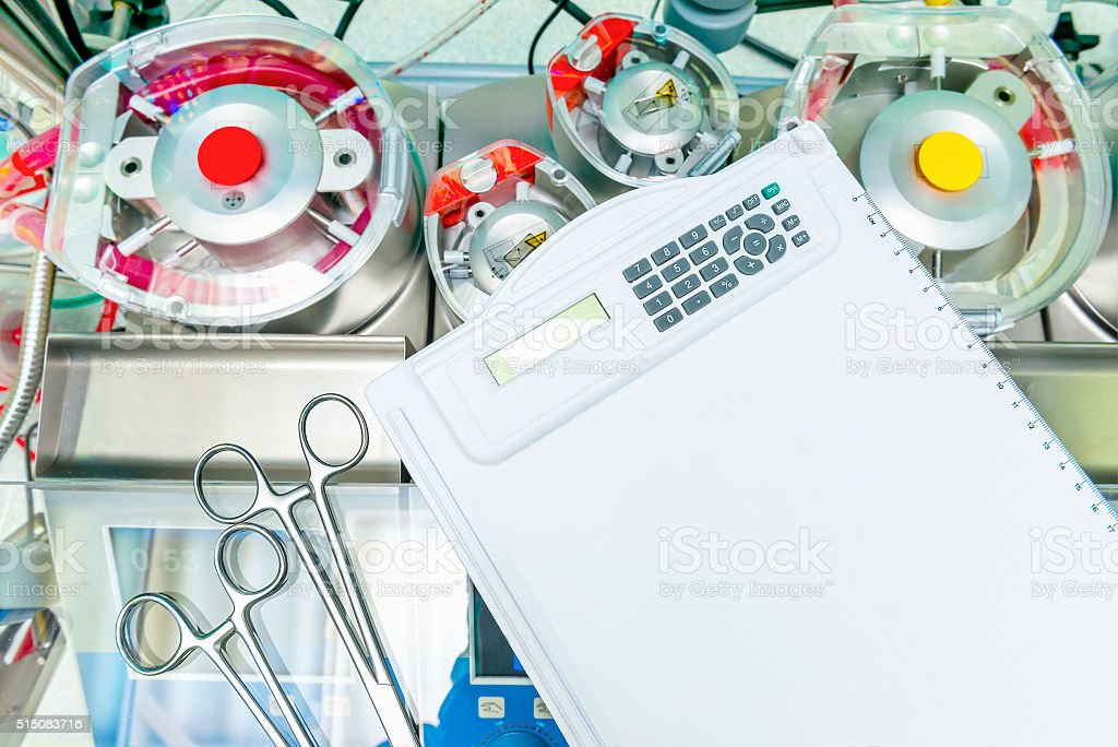 Heart lung pump and a writing tablet stock photo