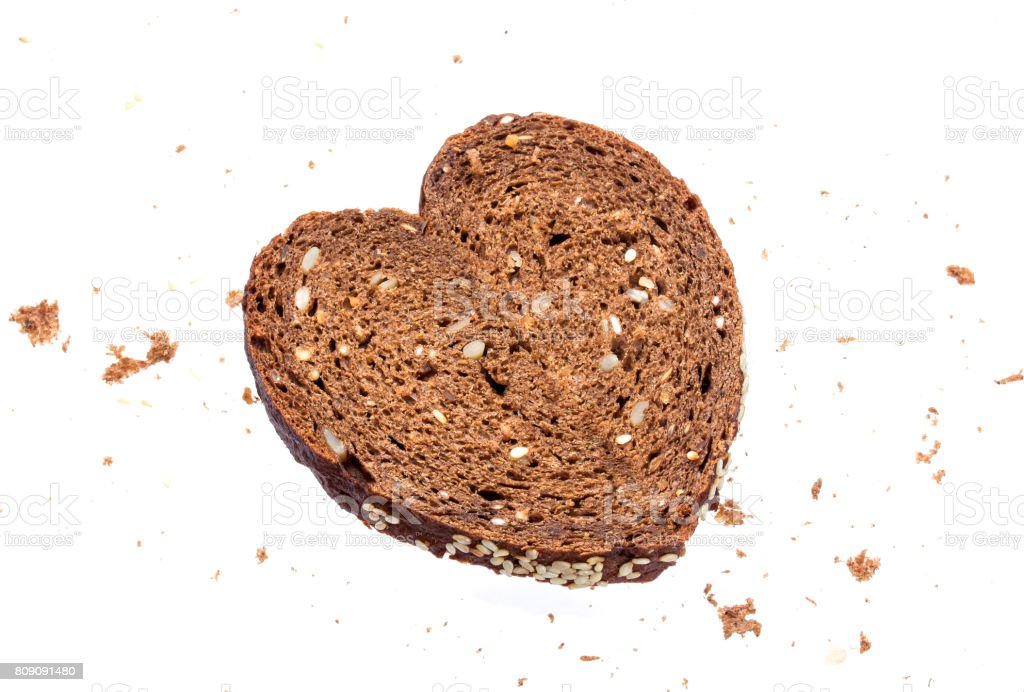 Heart made from bread on white background stock photo