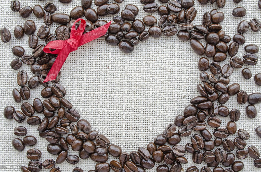Heart made from coffee beans on textured sack royalty-free stock photo