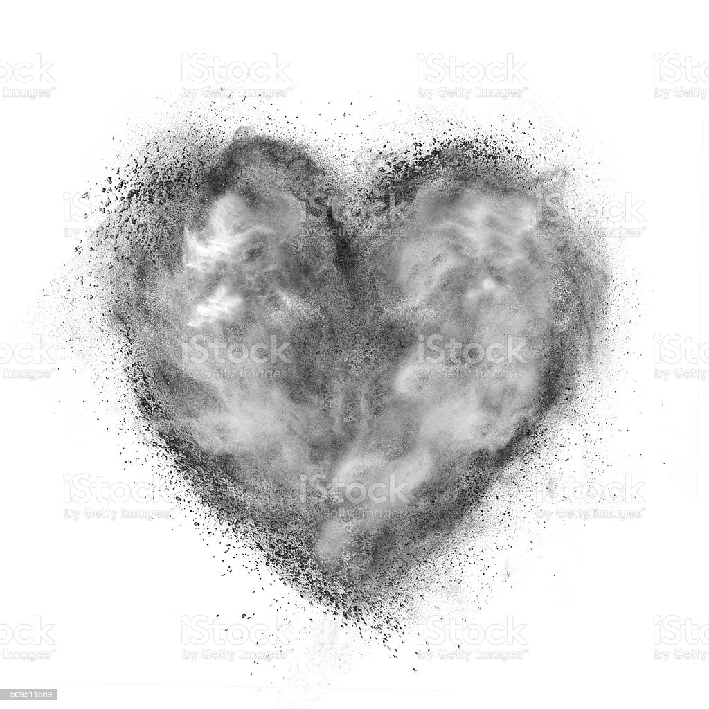 heart made of black powder explosion isolated on white stock photo