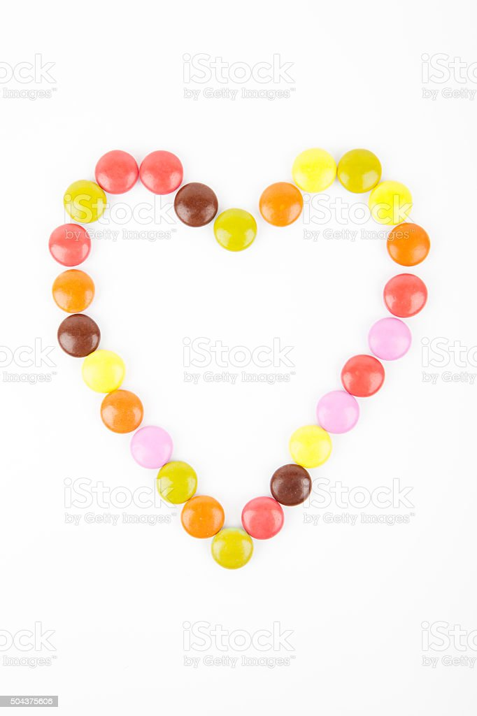 Heart made of colored candies stock photo