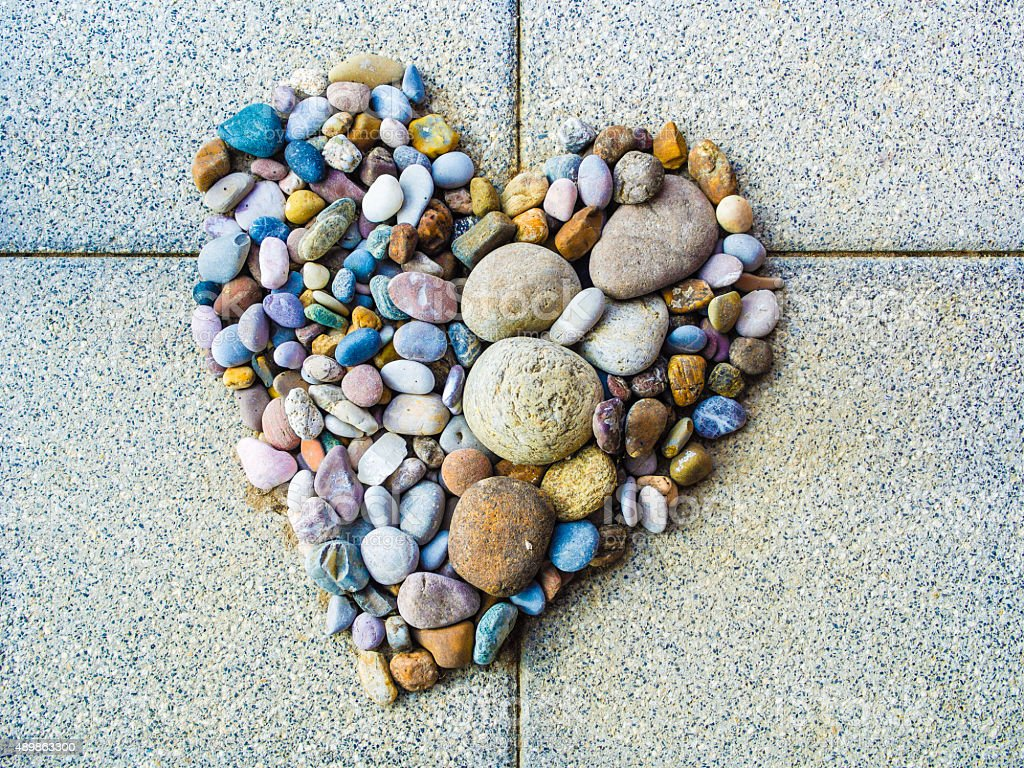 Heart made of pebbles, symbol and illustration of love romance...
