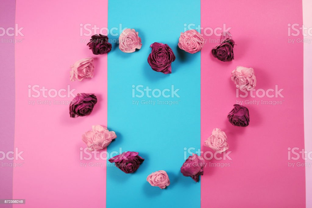 Heart made of dried rose buds, Valentines day background stock photo
