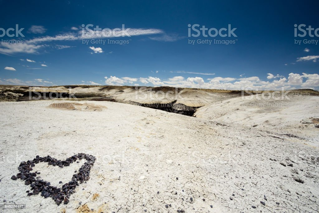 heart made of pebbles in the dry new Mexico desert stock photo