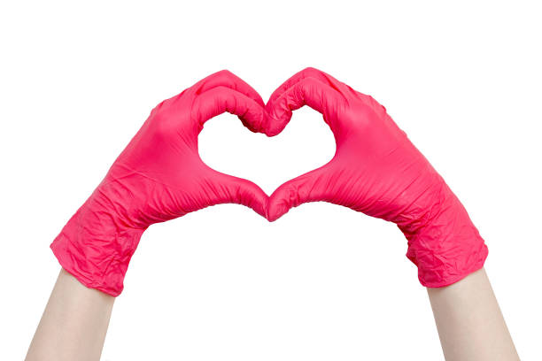 Heart made of red medical gloves Heart made of red medical gloves, Healthy lifestyle, benefits of vitamins, vaccination, afraid of injections, medical store, pharmacy, presentation, quick recovery, useful habits, proper nutrition surgical glove stock pictures, royalty-free photos & images