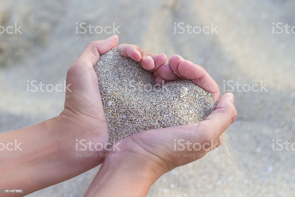 Heart made of sand stock photo