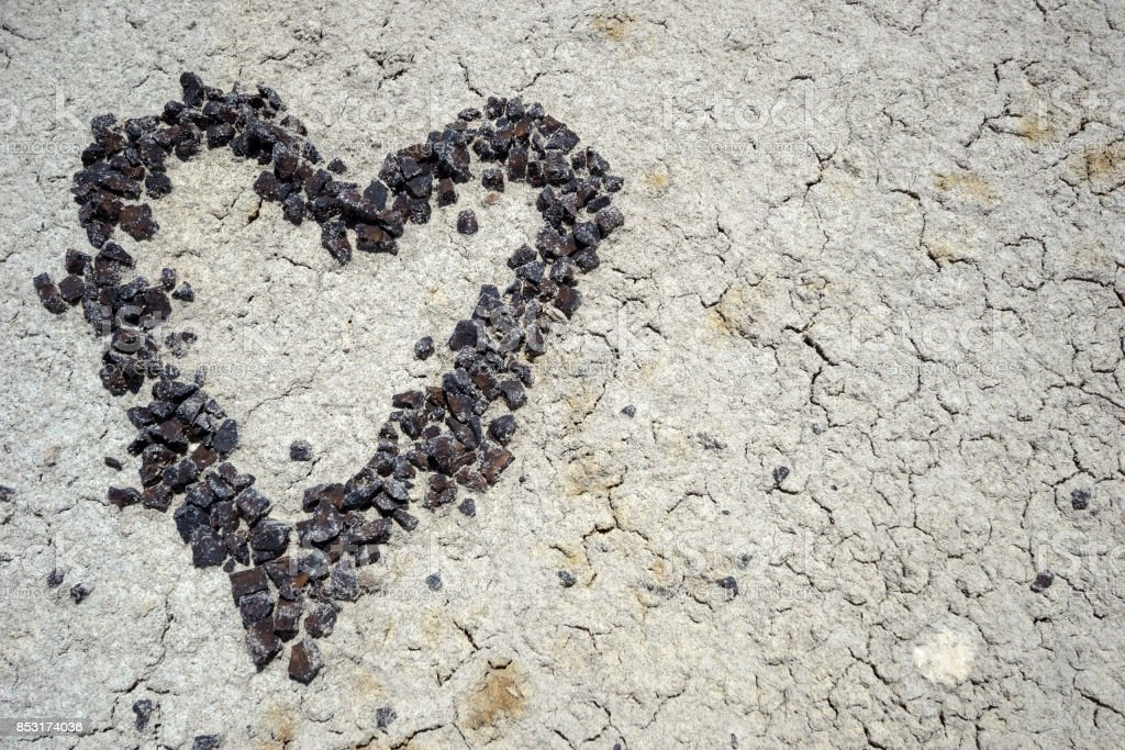 heart made of stone pebbles on earth stock photo