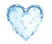 Heart made of water splashes on blue