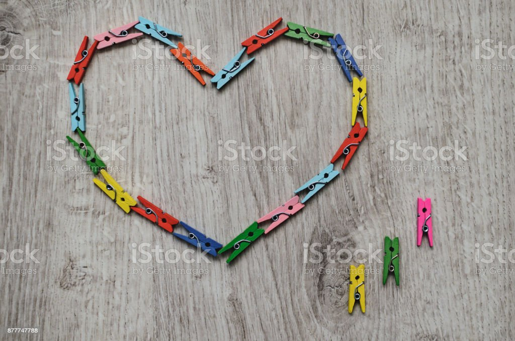 Heart made of wooden clothespins stock photo