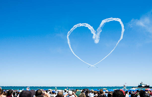 Heart made out of a planes smoke trail stock photo