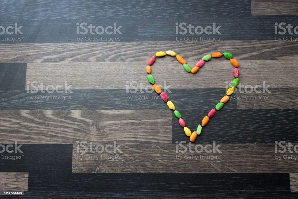 Heart made out of colorful rice on a gray kitchen counter top royalty-free stock photo