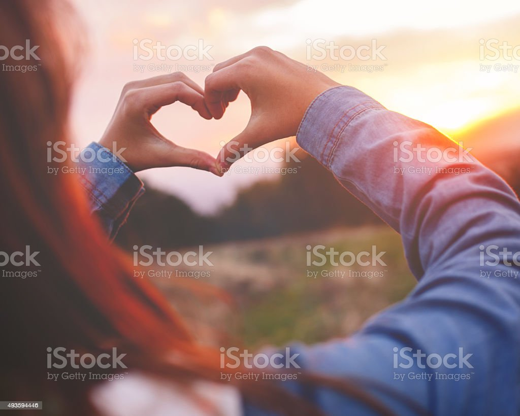 Heart made with hands stock photo