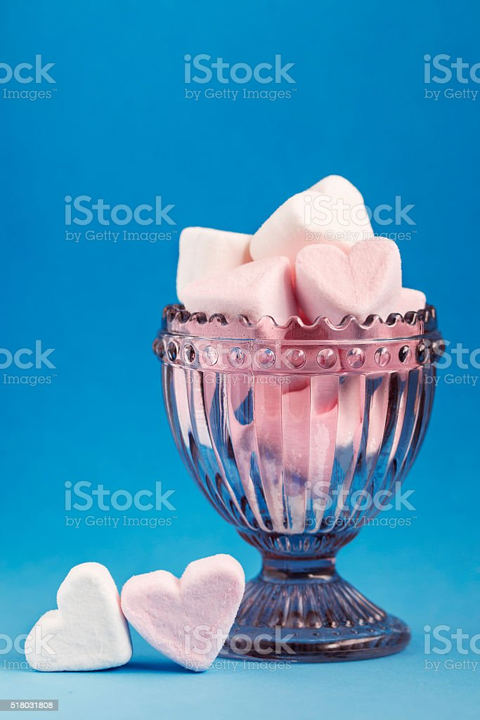 Heart marshmallows in a glass cup stock photo