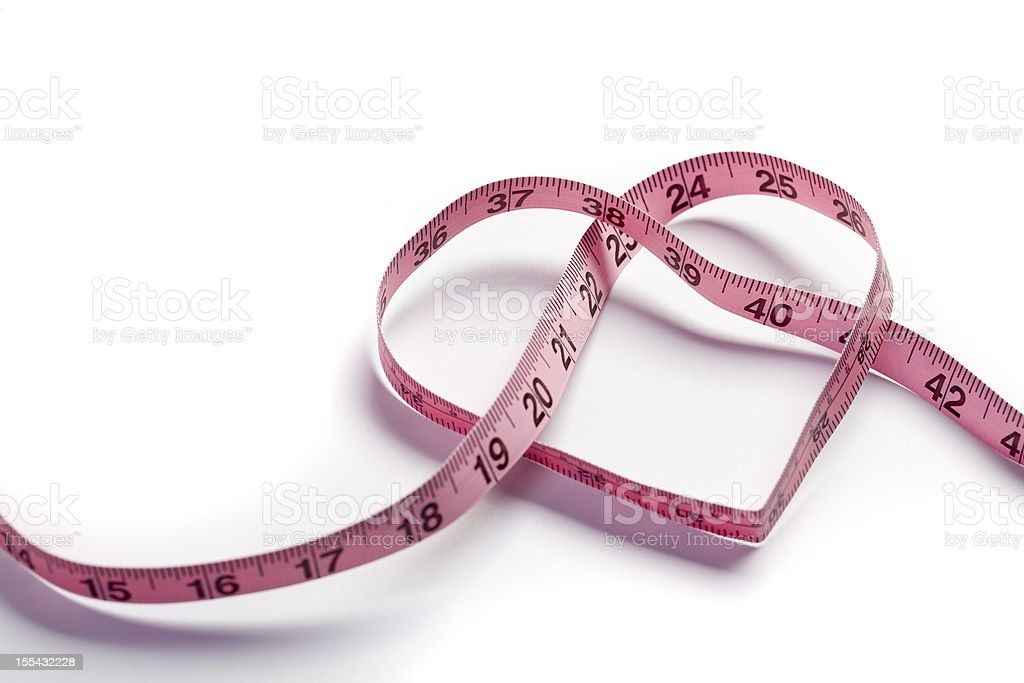 Heart measuring tape stock photo