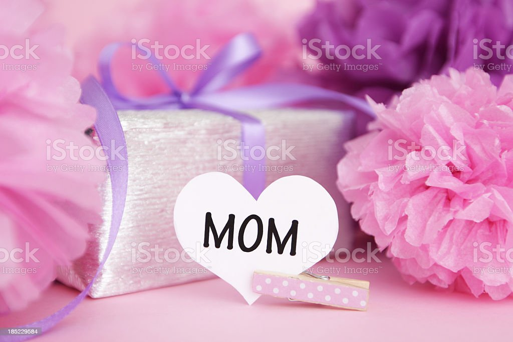 Heart Mom sign, gift box and pom pons royalty-free stock photo