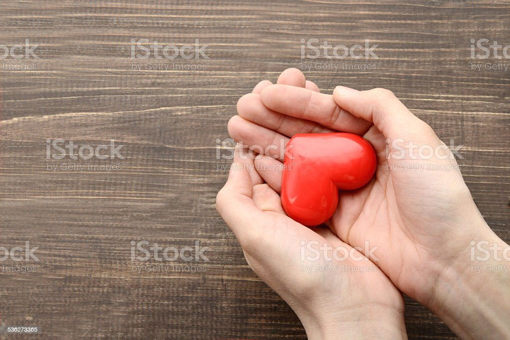 Heart object in female hand stock photo
