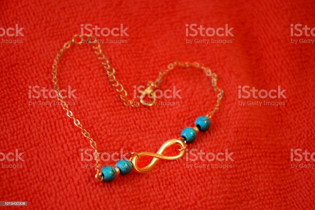 Heart Of A Gold Chain On A Microfiber Cloth The Symbol Of Infinity