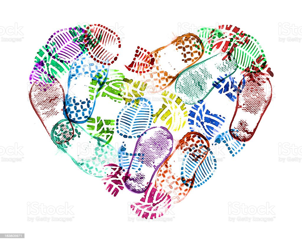 heart of baby shoe print stock photo