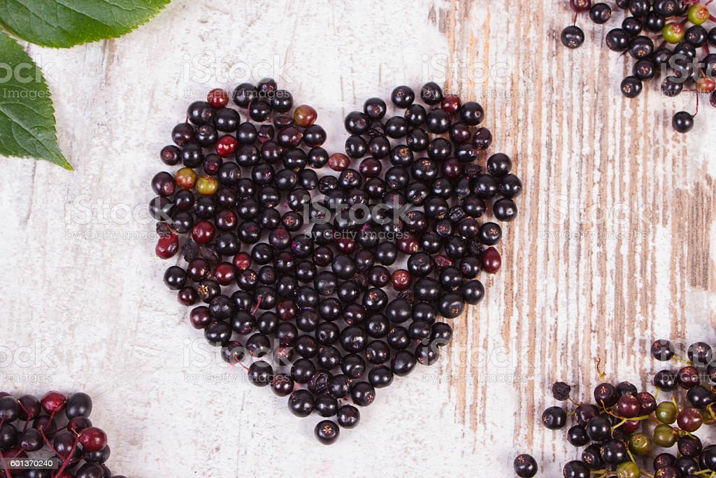 Heart Of Elderberry On Old Wooden Background Symbol Of Love Stock