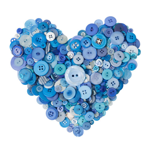 Heart of many different blue buttons. Heart of many different blue buttons. Isolated. button sewing item stock pictures, royalty-free photos & images