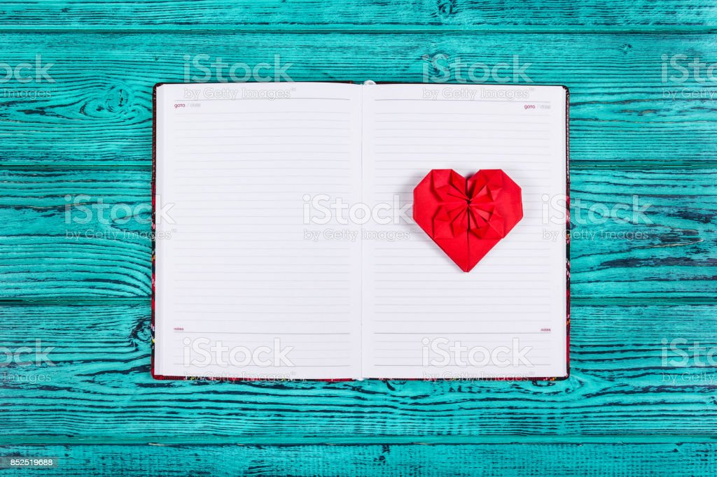 Heart Of Origami Of Red Paper Open Notebook With Clean Pages And A