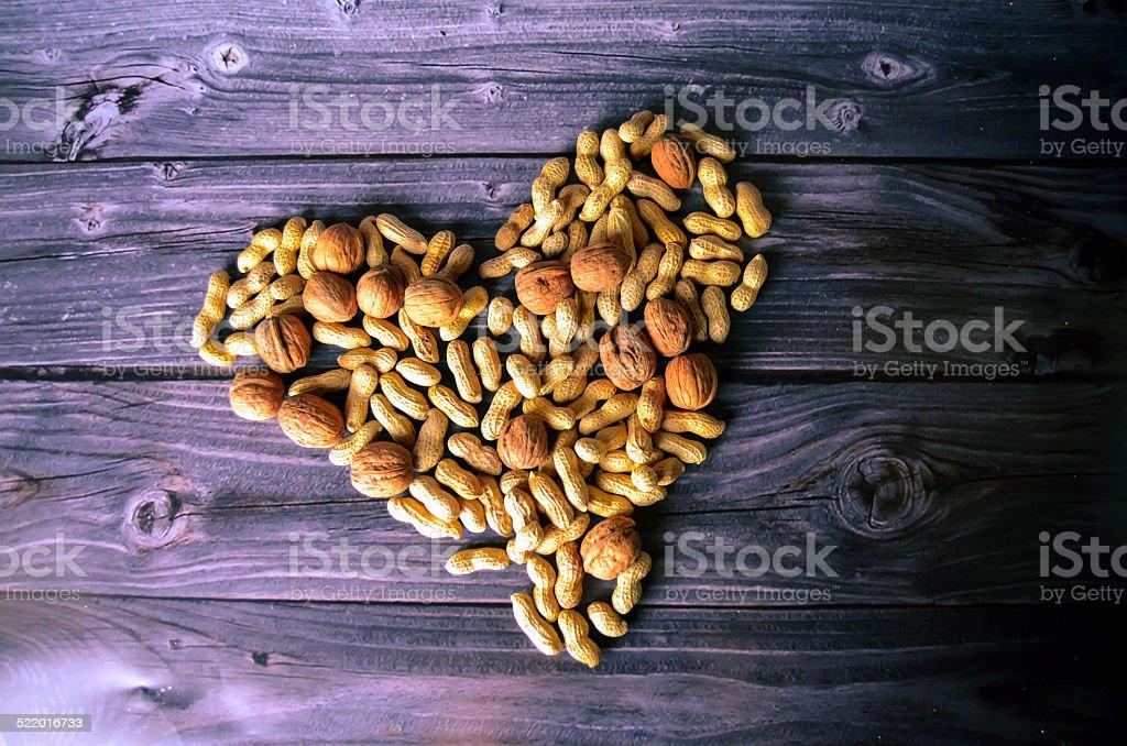 Heart of peanuts stock photo