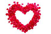 istock Heart of pink rose petals 690072396