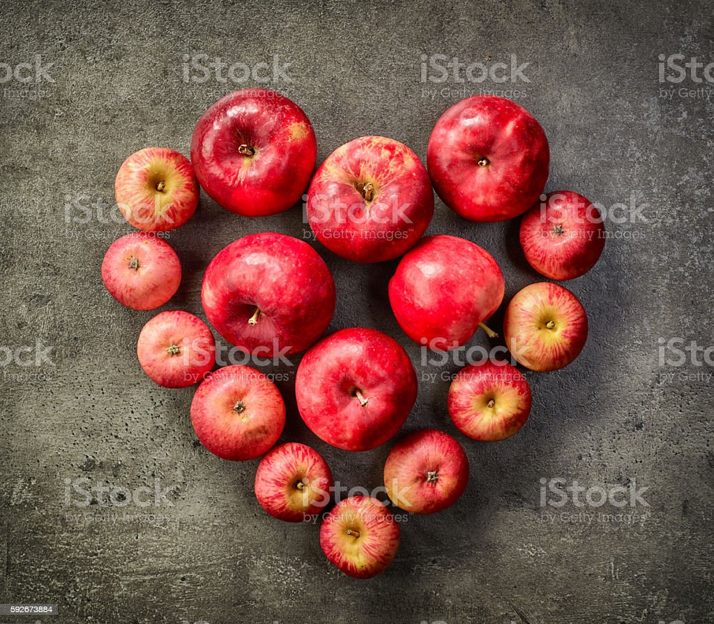 heart of red apples stock photo