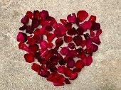 istock Heart of red rose petals 1134379396