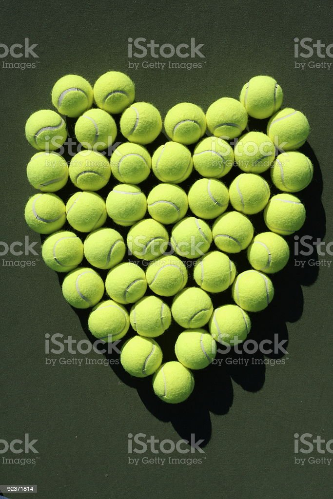 Heart of tennis balls royalty-free stock photo