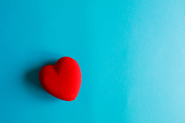 Heart on a blue paper background Heart on a blue paper background consoling stock pictures, royalty-free photos & images