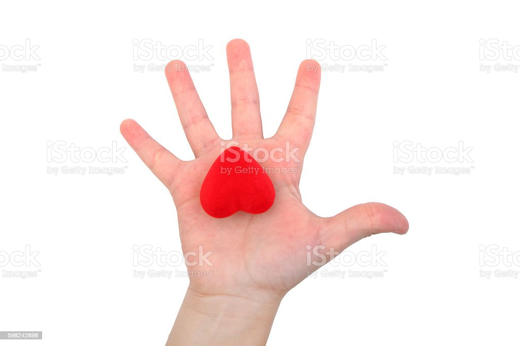 Heart on a child's hand stock photo