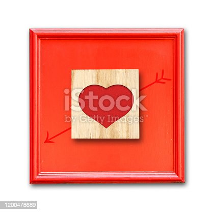 istock Heart on a wooden block in a red frame. Isolated. Happy Valentine's day background. 1200478689
