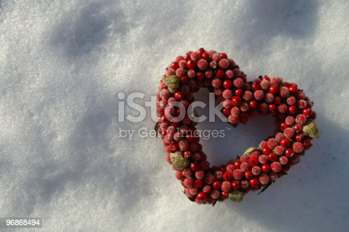 istock heart on background of snow 96868494