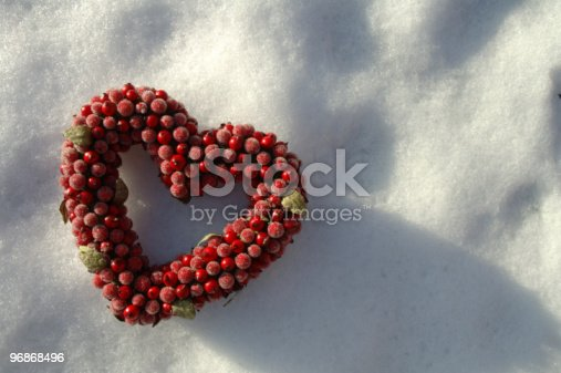 istock heart on background of snow 96868496
