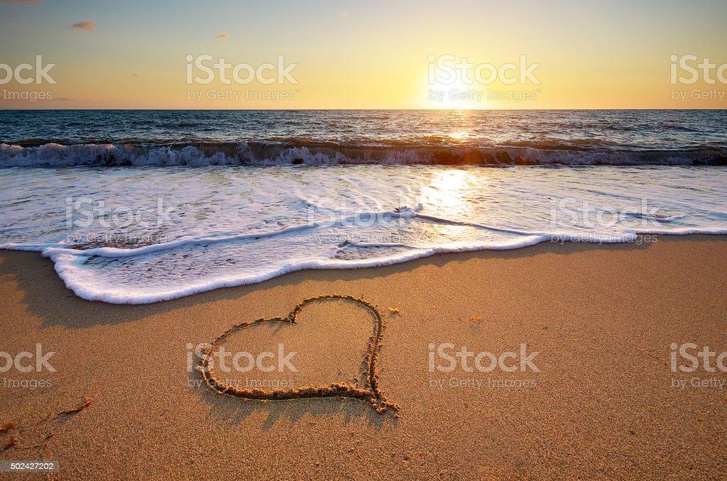 Heart on beach stock photo