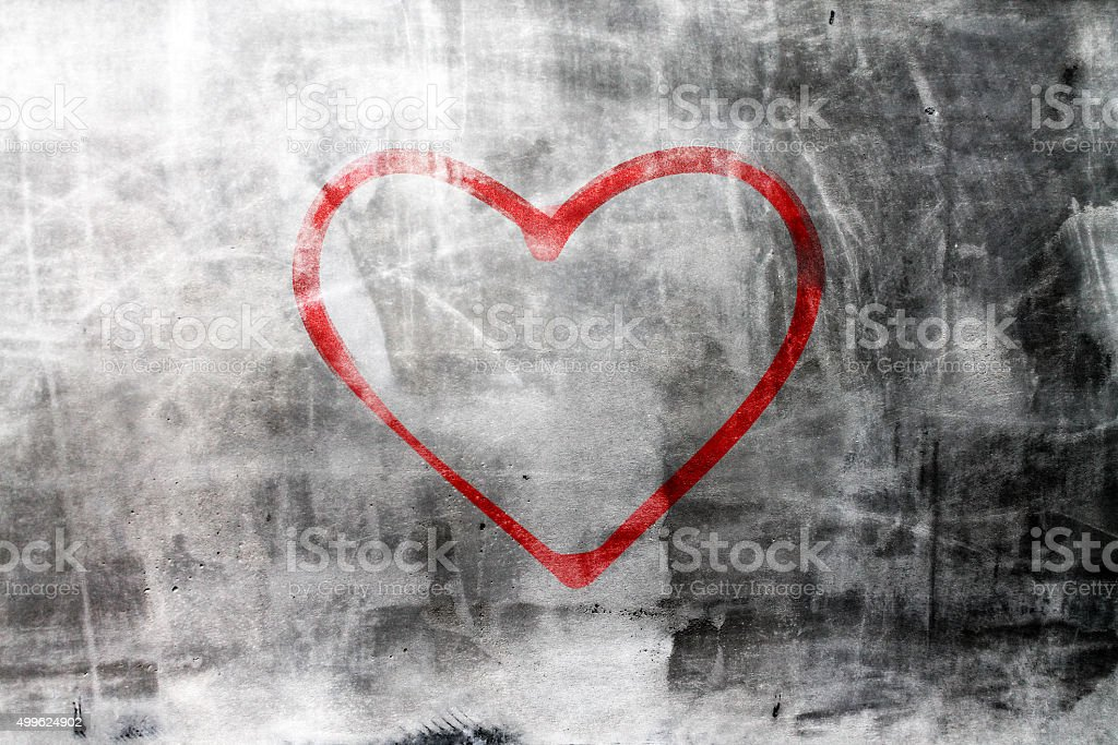 Heart on concrete wall stock photo