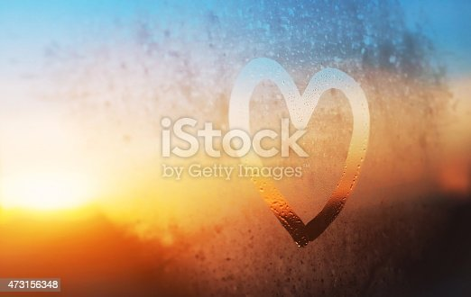 istock heart on misted window 473156348