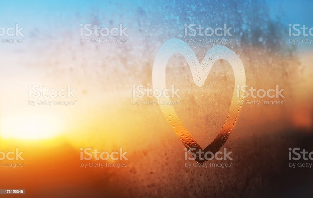 heart on misted window stock photo