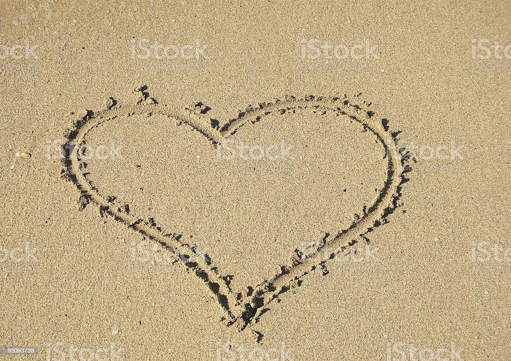 Heart on sand stock photo