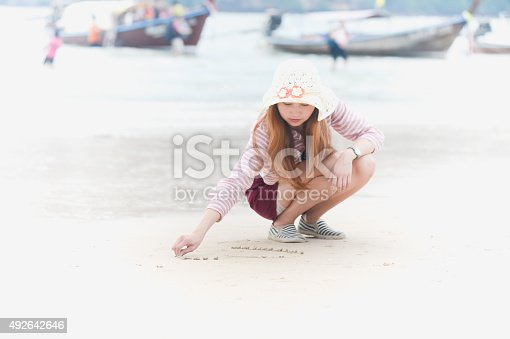 Heart on the beach hand asia woman is writing